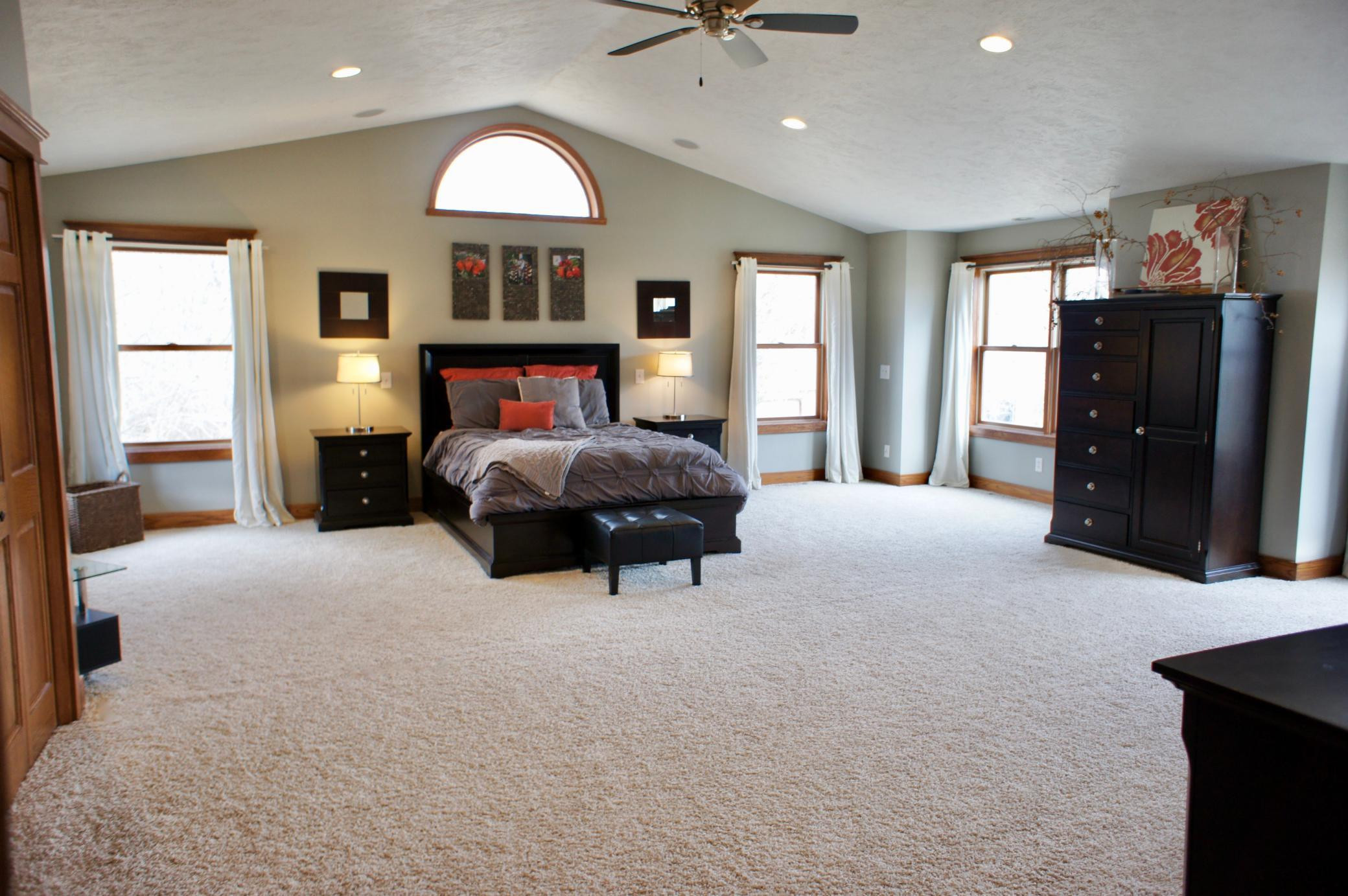 Spacious doesn't begin to describe this upper level master bedroom.