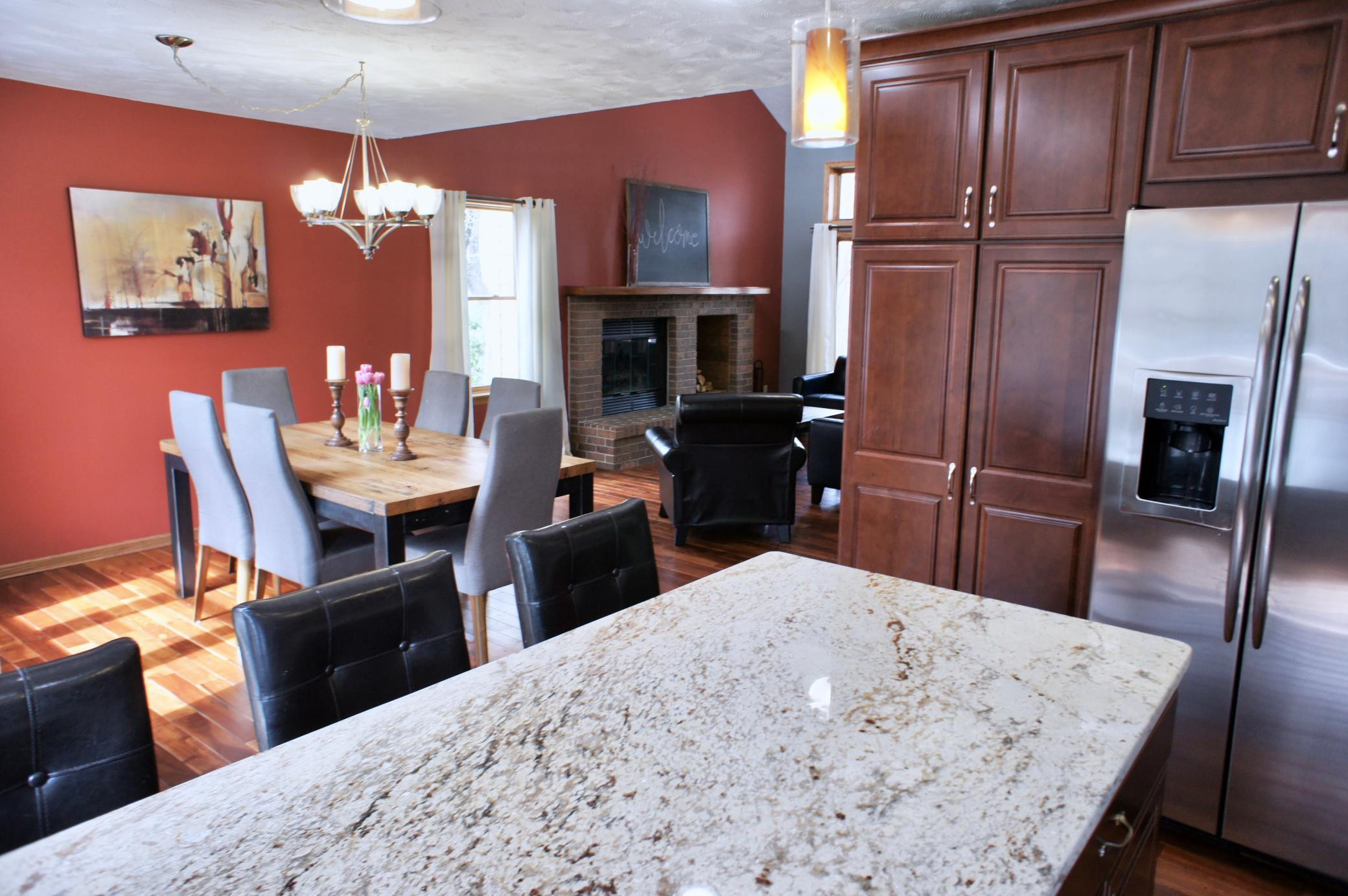 A great view the the kitchen island space overlooking the dining and living rooms