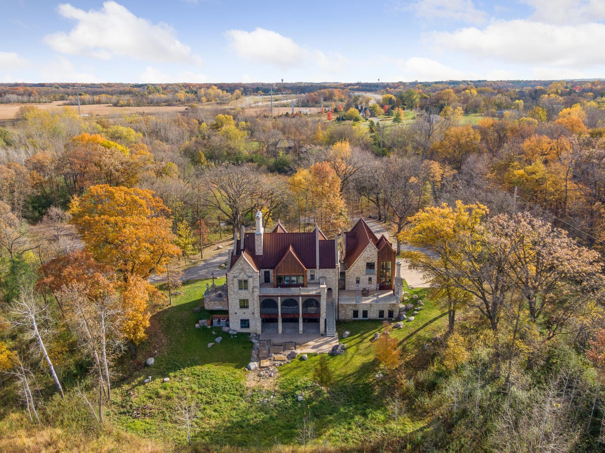One-of-a-kind estate, this impressive castle sits within an enchanted forest. Opportunity to add detached garage, pool and custom entrance gate.