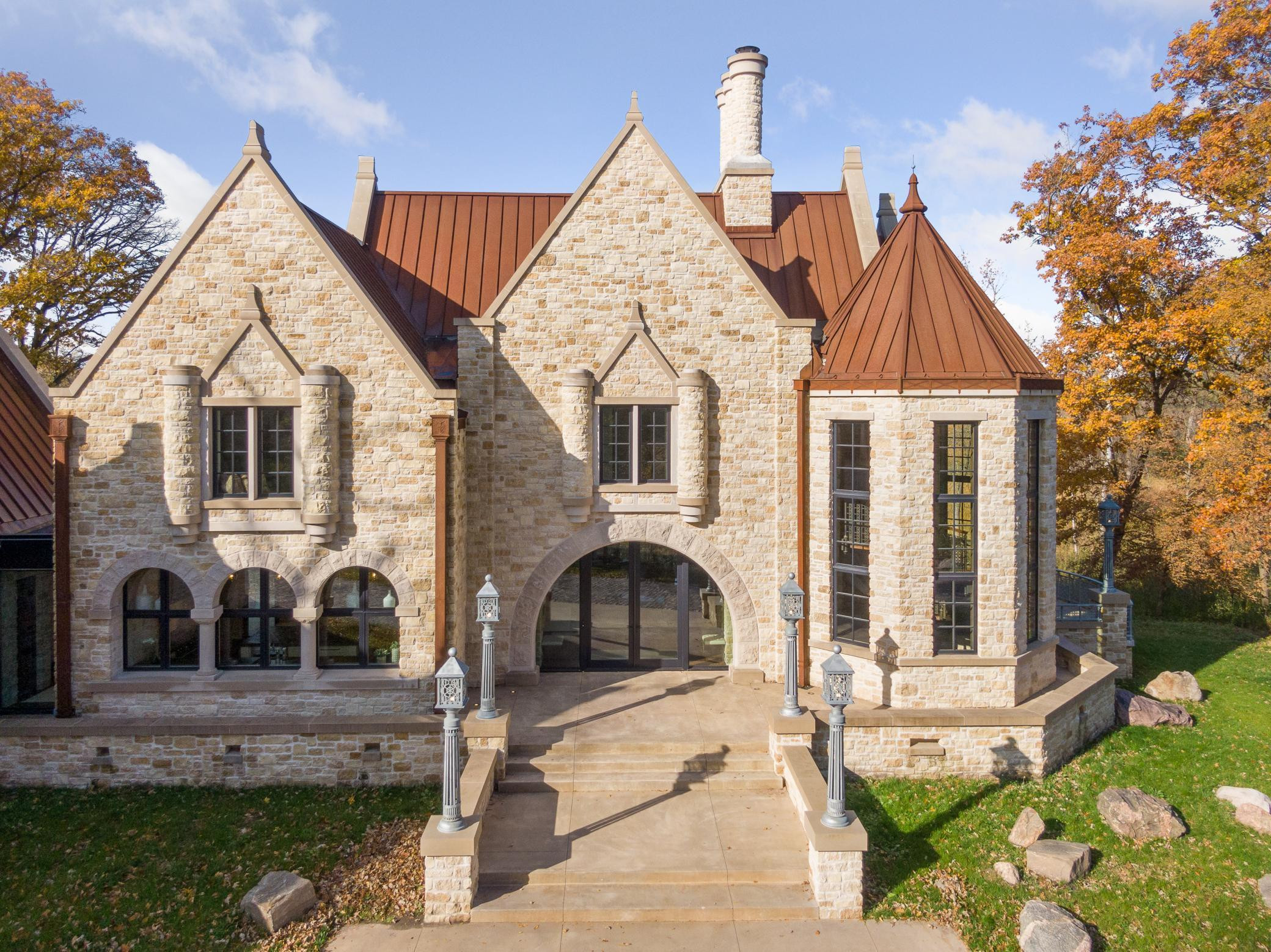 Beautifully constructed and architecturally sound! The property announces its presence with solid Saint Croix Valley limestone blocks. Fun fact: 45 truckloads of solid limestone delivered and tumbled onsite to create this incredible masterpiece.