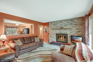 Full Wall Fireplace and open view to the kitchen