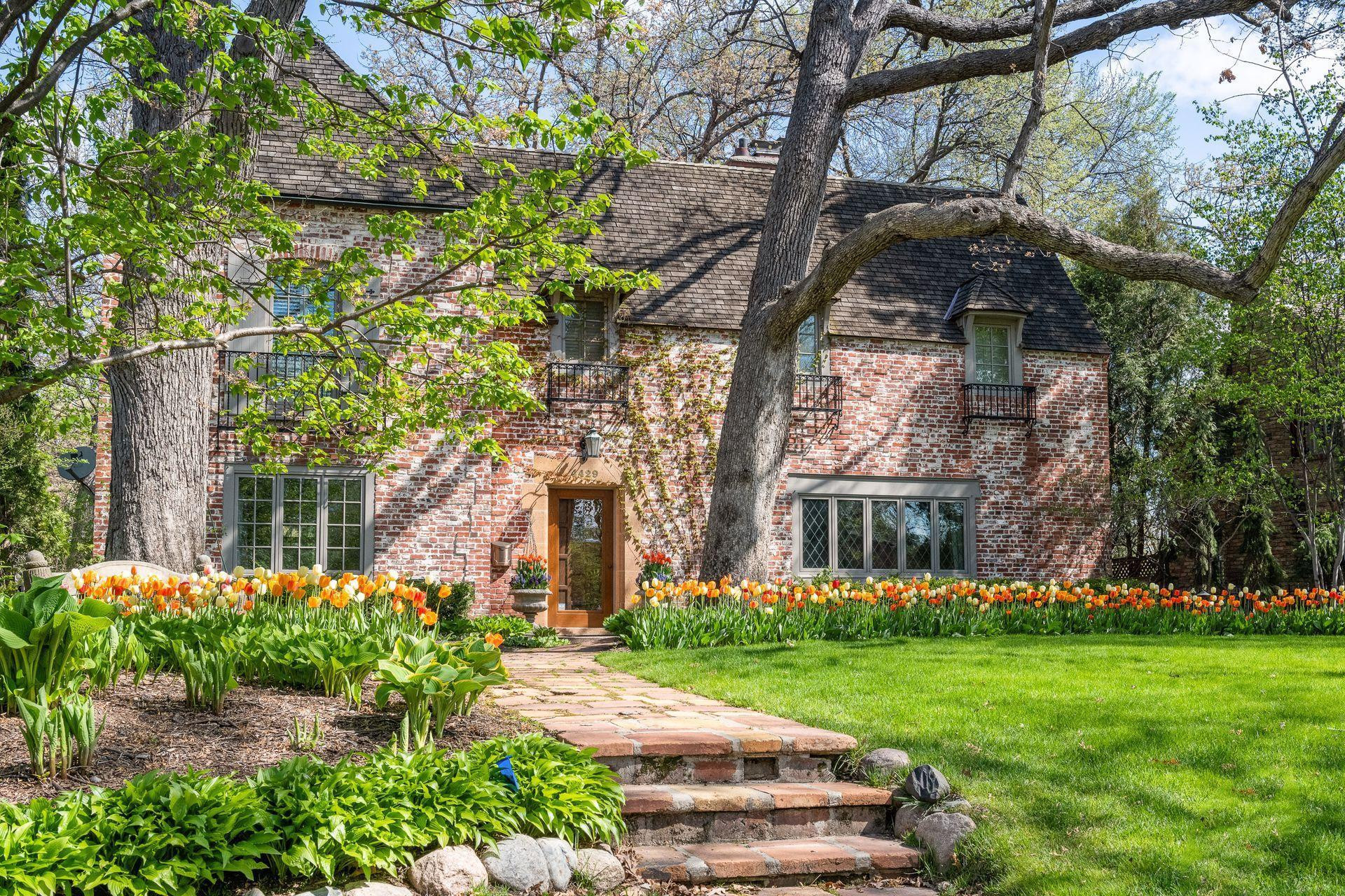 THE ARCHITECTURAL DETAILING OF THIS CHATEAU STYLE MANSE WAS INSPIRED BY A NOTED TWIN CITIES ARCHITECT WHO DESIGNED THE HOME FOR HIS FAMILY TO REFLECT UPON THEIR FREQUENT SUMMERS SPENT IN NORMANDY.