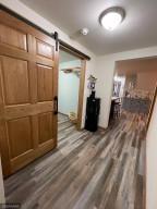 Hallway with new barn door on laundry room