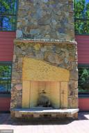 Main Level Patio Fireplace and Climbing Wall 1