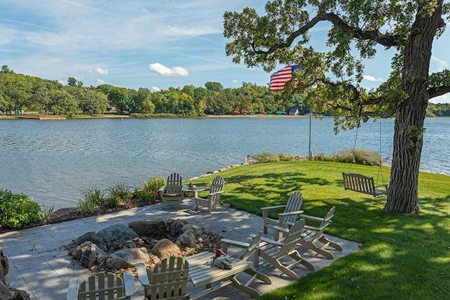 View of the point with a large fire pit perfect for entertaining.