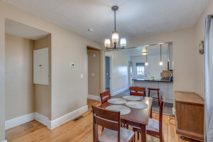Open dining room flows nicely between living room and kitchen