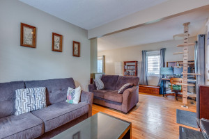 Open floor plan allows for smooth transition between living room, dining room and kitchen areas.