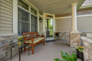 Spacious front porch has beautiful and practical coated floor