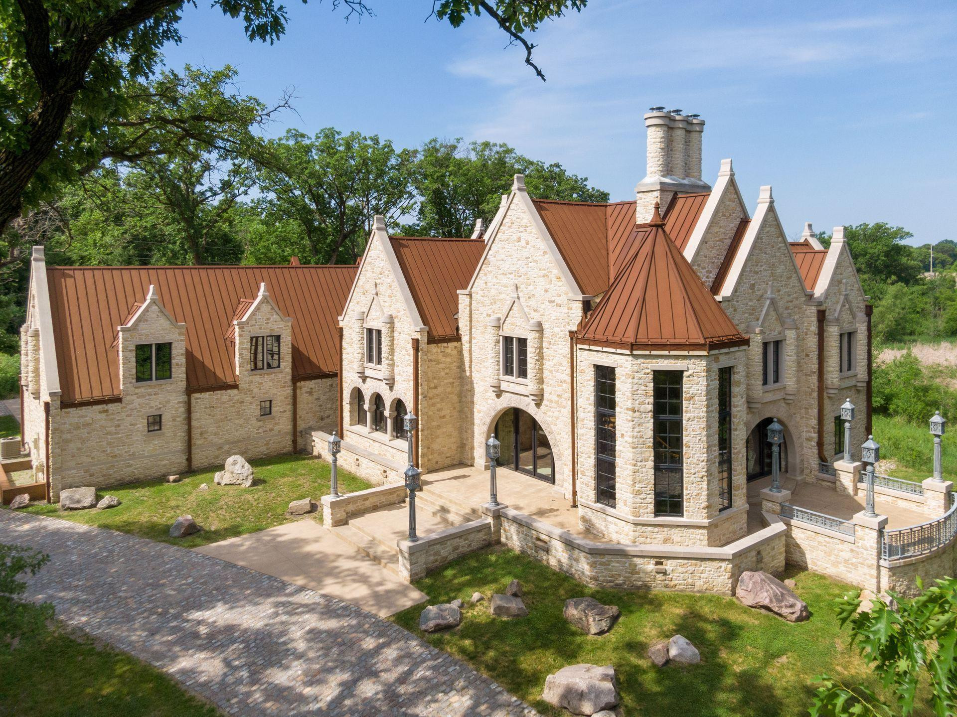 Situated on 3.37 acres in the coveted Orono countryside, Huntington Manor is a prestigious estate proudly designed by architect James McNeal and crafted by masonry artist Luke Busker, Masonry Builders, LLC.