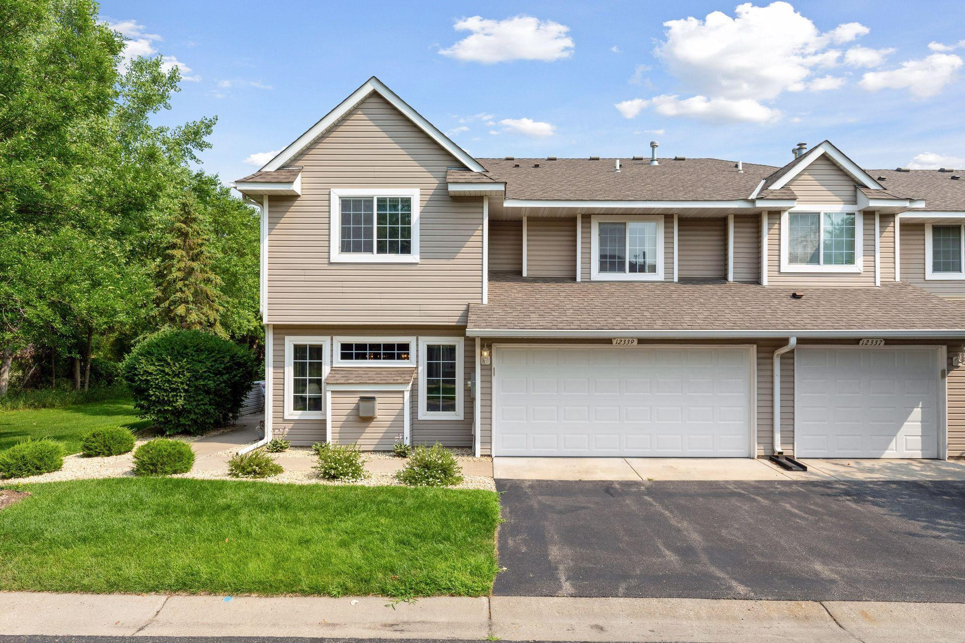 End Unit townhome overlooking a huge wooded green space!