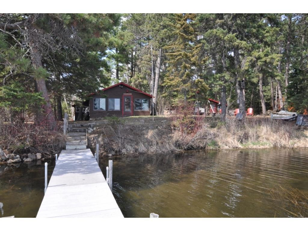 Mantrap Lake getaway with main cabin, Vintage Log Cabin, Bunk House and Garage.