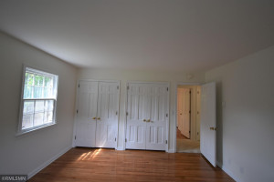 Master bedroom with refinished wood flooring.