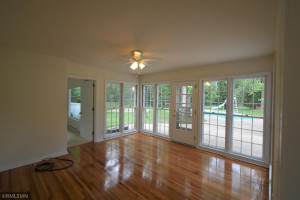 Original wood flooring recently refinished brightens this room.