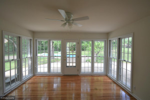 Sunroom has an abundance of natural lighting to enjoy your morning cup of coffee.