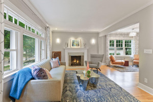 Gas fireplace with beautiful tile surround and wood mantle.
