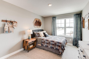 Each of the home's three secondary upper level bedrooms are abundant in space! (Photos of the same floorplan, colors are similar).