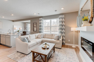 Another look at the main level family room, which flows conveniently with the rest of the space provided in this charming layout! (Photos of the same floorplan, colors are similar)