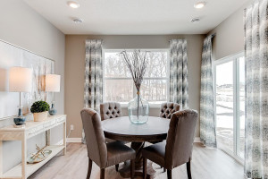 Tucked off the kitchen is the home's dining space - which resides just adjacent to a walkout exit onto the back patio and into your HUGE backyard!! (Photos of the same floorplan, colors may vary).