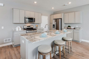 A kitchen built to perform - complete with stainless appliances and a vented microhood, stunning cabinetry and loads of space to maneuver about!! (Photos of the same floorplan, colors are similar).