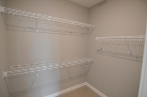 A peak inside the Primary closet - which is loaded with shelving! (Photo of same plan, colors are similar)