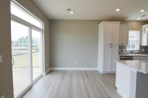 Tucked off the kitchen, the home's dining area is nicely sized and sits in front of a sliding glass door that will exit out onto a 16x8 concrete patio! (Photo of same plan, colors are similar)