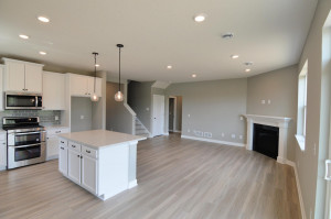 The epitome of the open concept home design - with the bonus of soaring windows shedding natural light throughout the entire main level living areas!! (Photo of same plan, colors are similar)