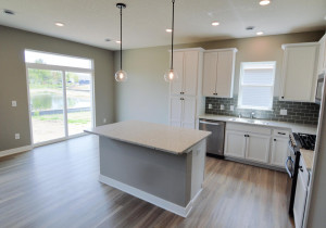 One last peak at the kitchen space, which resides just adjacent to the home's dining space and pours into the rest of the main level! (Photo of same plan, colors are similar)