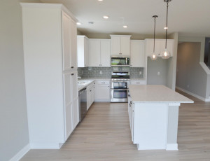 A kitchen that just makes sense! One of the man advantages in the new home design!! (Photo of same plan, colors are similar)