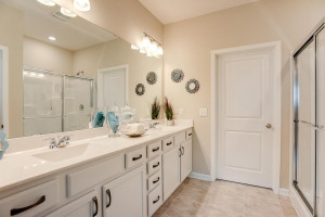 Tucked back adjacent to the primary suite, this oversized bath features a walk-in shower, and 36-inch high dual vanities - plenty of storage! *Photo of previous model, selections will vary.