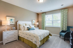 Enjoy starting your day in the comfort of your beautiful primary suite. Located just off the dining room, this primary suite makes main level living easy. *Photo of previous model, selections will vary.