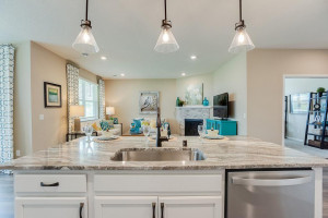 Open, inviting and soaked in natural light - the home's living spaces flow seamlessly out from the kitchen; a theme consistent throughout the entire layout!! *photo of previous model, selections will vary.