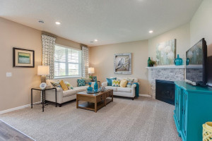 The open feel extends into to the main level family area - which is every bit as inviting and it is beautiful! *Photo of previous model, selections will vary.