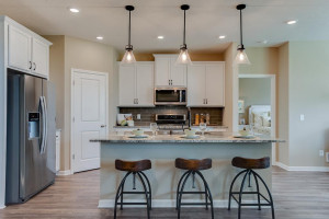 The kitchen has ample counter space (including seating at the island!) and lots of cabinet space. The perfect space for making everyday meals or memorable special occasion dinners.... *Photo of previous model home, selections will vary