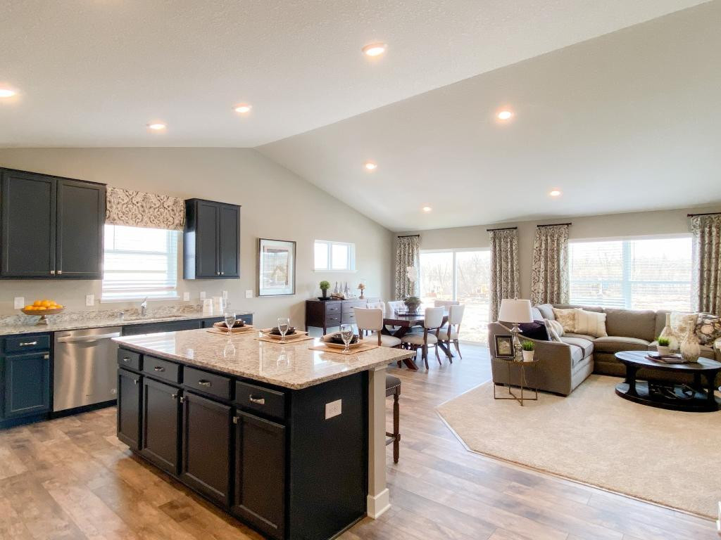 Check out this open concept main level. Kitchen, living, & dining all easily accessible. Plenty of room for entertainment and extra seating with the large kitchen island. Model home photo, colors and finishes will vary.
