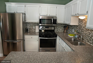 Stainless Steel Appliances welcome you to the kitchen along with the Granite Counter Tops and SS under-mount sink!