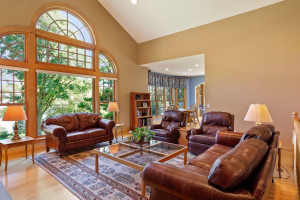 The main level features maple hardwood floors from the front door and through to the kitchen and four season porch.