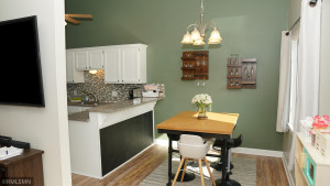 The Vaulted Ceiling with recently replaced Skylights and Large Windows makes the space feel bright and cheerful. The Informal Kitchen/Dining Room flows to the Raised Granite Breakfast Bar.