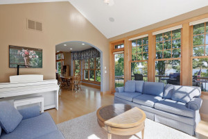 The four season porch is wired for audio with built-in speakers. The patio door leads out to the new deck.