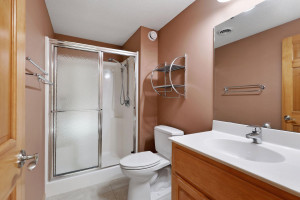 A 3/4 bathroom is adjacent to the changing room.