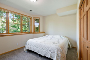 Two of the bedrooms feature bay windows that look towards the lake.