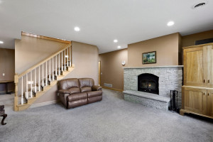 The lower level family room enjoys a second wood burning fireplace.