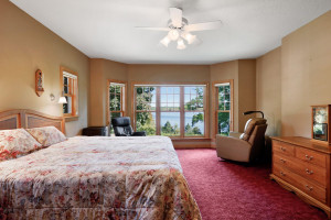 The main floor master is a tranquil retreat with a wall of windows offering long lake views.