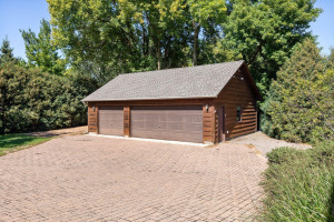 Hard-to-find, there is a second 3 car garage that is plumbed with heat and is a great workshop or man cave!