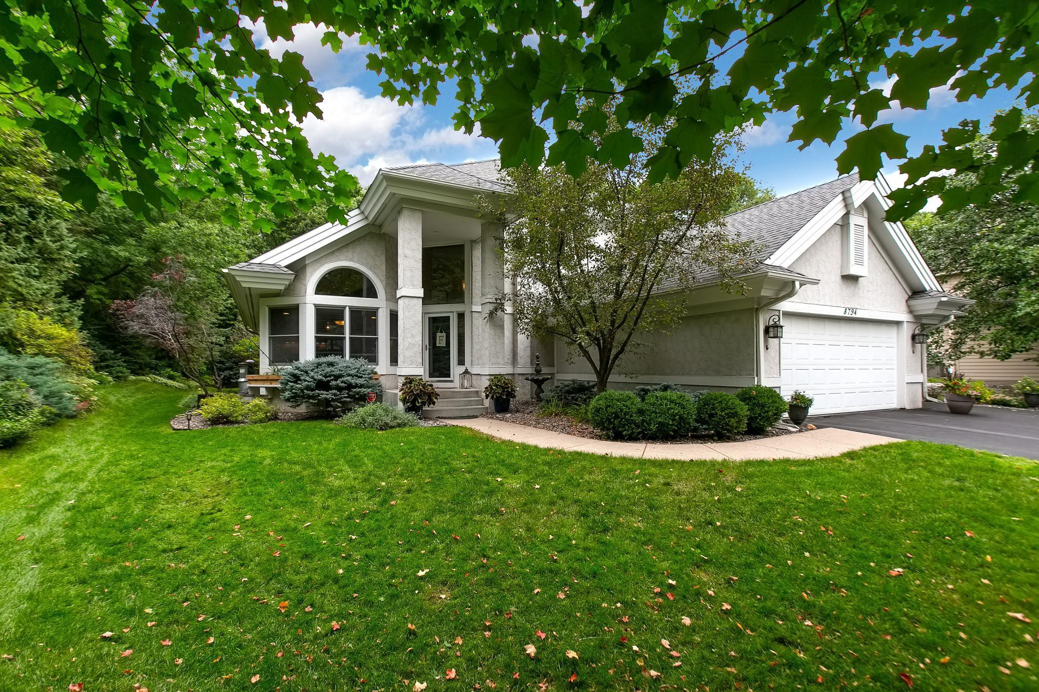 Lovely 4 Bedroom, 4 bath two story home in sought after Big Woods.