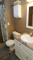 Tiled lower level bathroom that is accessed from the bedroom.