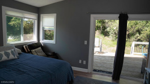 Another Look at the Upper Level Bedroom and Outdoor Entertaining Space on the Deck.
