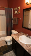 The Upper Level Bathroom is accessed from the Hall, but also from the Upper Level Bedroom Walk-In Closet.