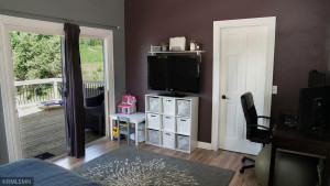 The Master Bedroom flows out to the Deck and is large enough to Work From Home!