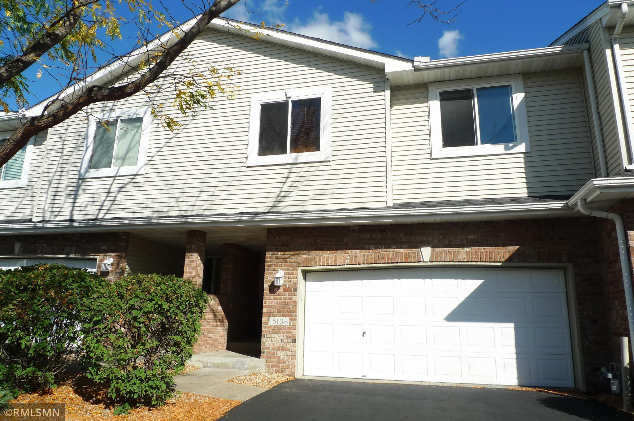 In-demand Claret Springs townhome backs to a nature area and pond!