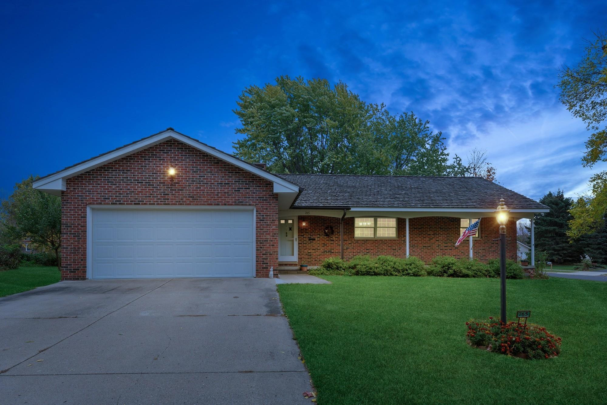 Welcome to this Ray Cox custom-built home with full brick surround, shake roof with gutters on an impeccable third acre lot with mature trees in the back.